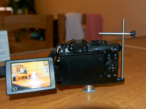 The bracket attached to the camera.