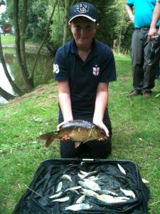 Alex Warham's 4lb 15oz with this lovely small carp