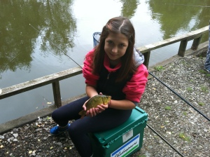 First timer Megan Higham was able to slip the net under this small Crucian carp