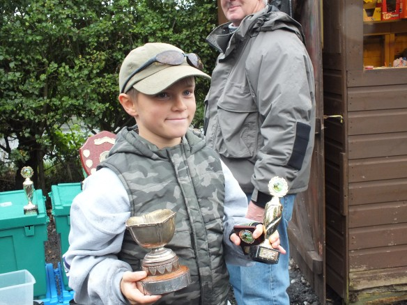 Richard Hansley collecting the Most Improved angler of the year, plus a section trophy from Mersey CADG Match.