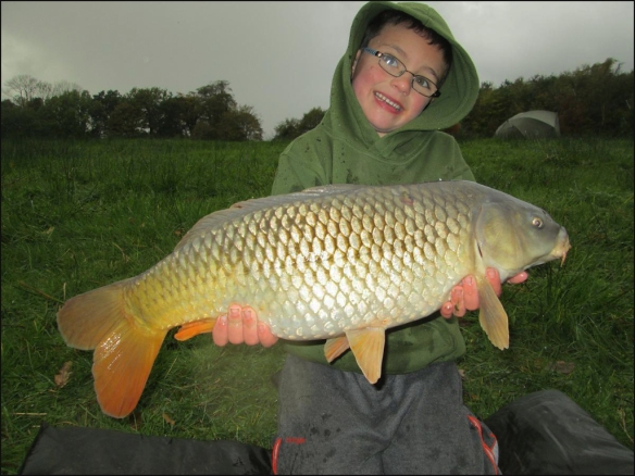 Young Ben with his common carp.