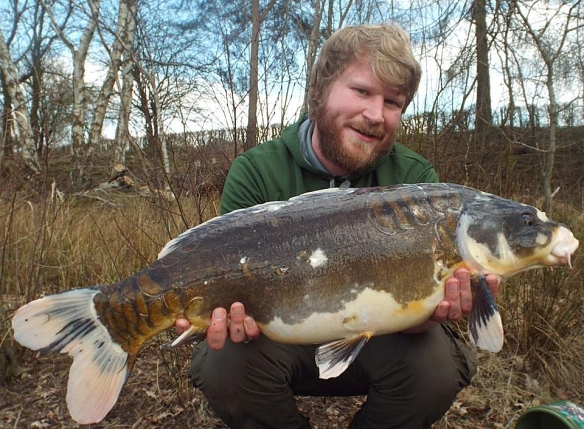 March COTM winner, Elliot Knox, proudly showing off his 22lb 2oz koi carp.